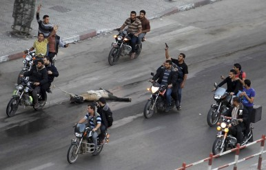 palestinian-gunmen-ride-motorcycles-they-drag-body-man-who-was-suspected-working-israel